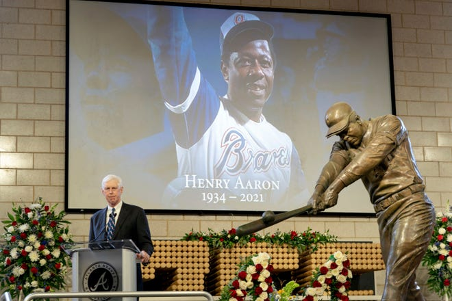 """Atlanta Braves Chairman Terry McGuirk speaks during """"A Celebration of Henry Louis Aaron,"""" a memorial service celebrating the life and enduring legacy of the late Hall of Famer and American icon, on Tuesday at Truist Park in Atlanta."""