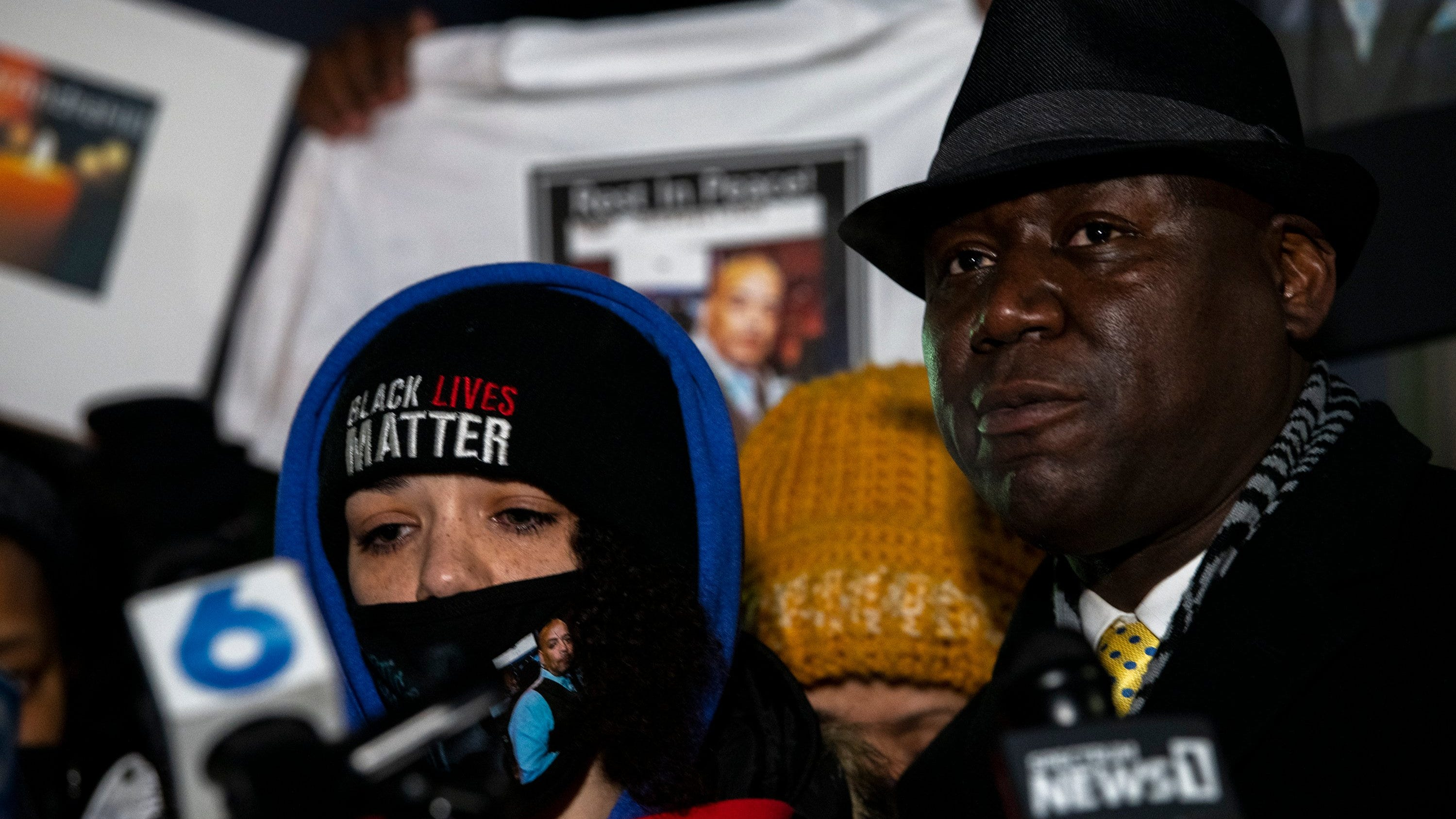 Karissa Hill, daughter of Andre' Hill, stands beside Attorney Ben Crump during a vigil being held for her father at Brentnell Community Recreation Center on Dec. 26, 2020.