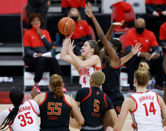 Ohio State Buckeyes guard Jacy Sheldon (4) makes a runner in the lane ahead of Maryland Terrapins guard Diamond Miller (1) during the third quarter of the NCAA women's basketball game at Value City Arena in Columbus on Monday, Jan. 25, 2021. Sheldon finished the game with 21 points in the 88-86 win.