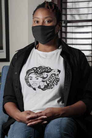 Artist April Sunami, at her home on the East Side, designed a T-shirt honoring important Black women in her life that will be sold nationwide by Lane Bryant.