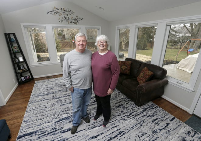 Julie and Garth Garlock did a first-floor addition of a mudroom, laundry, bedroom and bathroom, and also extended their existing sunroom during the past year.