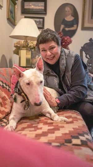 Martha Teichner with her beloved Minnie at home in New York.