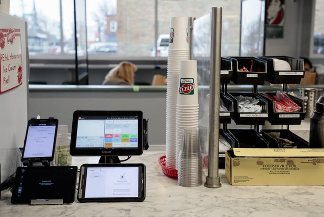 Tablets display incoming orders for GrubHub, UberEats and DoorDash at Ritzy's in Clintonville.