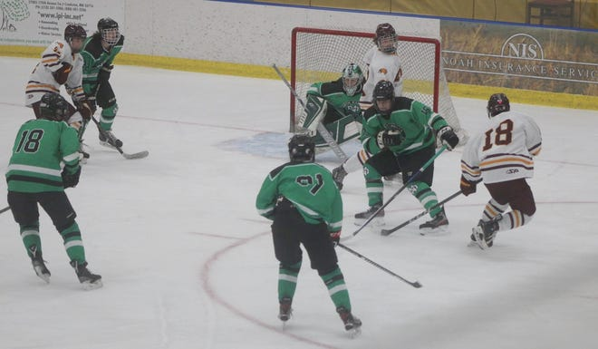 Casey Kallock (18) and the Minnesota Crookston hockey team beat North Dakota 7-2 in its home opener at the Crookston Sports Center.
