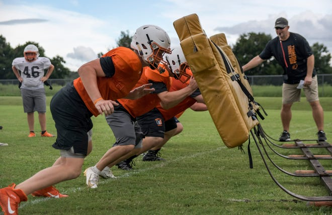 Linemen runs drills during practice at Umatilla High School on Thursday, Aug. 1, 2019.