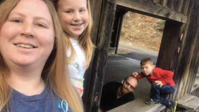 The Rhoney family lost their home due to a fire. Pictured from left to right are: Amanda Rhoney, Gentry Rhoney, Michael Rhoney and Mychal Rhoney.