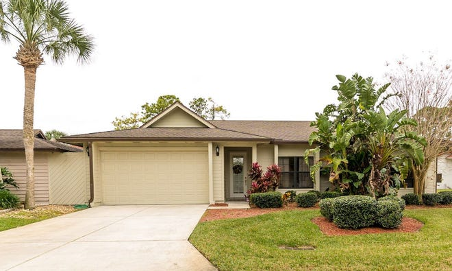 This impressive three-bedroom, two-bath home is located in the gated golf community of Pelican Bay.