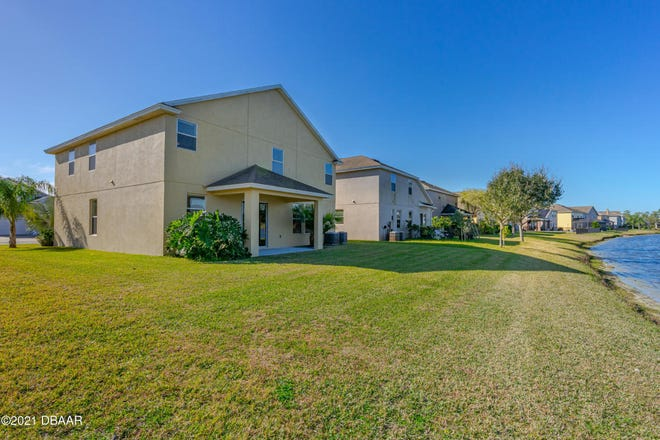 This beautiful home in a quaint Port Orange neighborhood is ideally situated on a stunning waterfront lot, with gorgeous views.