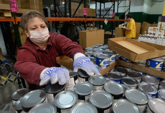 Volunteer Jackie Bules of Waterford Township loads food boxes at the Second Harvest Food Bank of Northwestern Pennsylvania on Jan. 26.