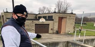 Rich Dunning, Hornell Water Pollution Control Plant operator, points out a buildup of sludge at the facility.