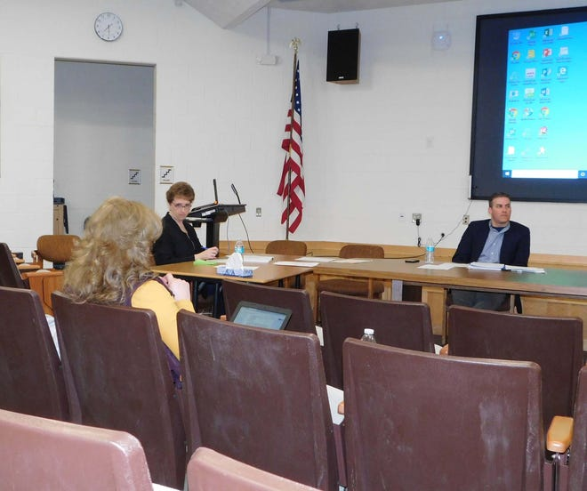 Central Valley school board members were spread out around the large group instruction room during a meeting last year.  Shown here are board member Jane North, board clerk Marsha Griffith and School Superintendent Jeremy Rich.