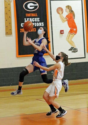 Narragansett's Julie Davis (12) goes up for a layup in front of Gardner's Krista Bettez during Monday evening's game at LaChance Gymnasium in Gardner. Davis led all scorers with 18 points as the Warriors earned their second straight win of the season.