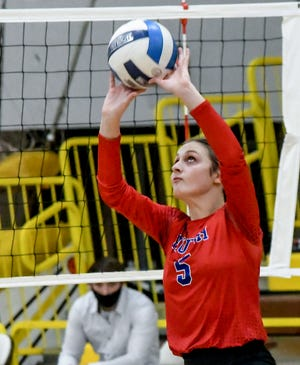 Hutchinson's Chloe Price sets the ball to a teammate during a volleyball match Monday in Garden City.