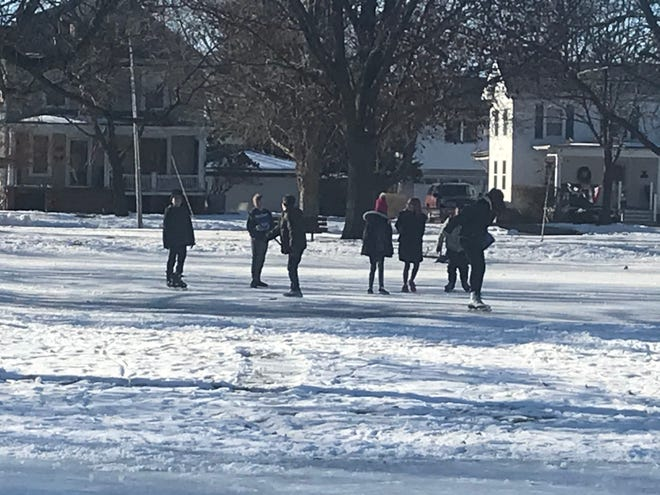 A group of kids enjoy the weather on Galva's ice rink