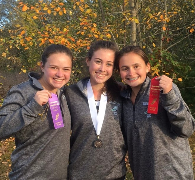 Meg Wajer, right, is seen with cousins Kylie Cahill (GHS Class of 2020), left, and Ryann Molinari (GHS Class of 2018), center, after the 2017 SWCL Cross Country Championship meet.