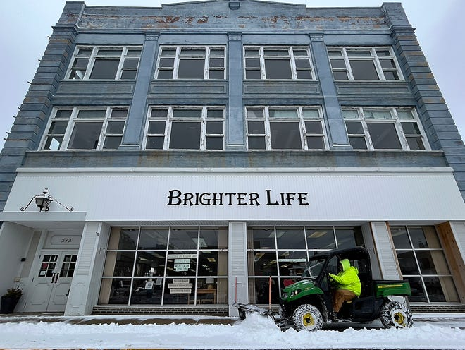 Galesburg Downtown Council director of maintenance Troy Morrison clears snow from the sidewalk in front of Brighter Life Bookshoppe Ltd., 292 E. Simmons St., on Tuesday, Jan. 26, 2021.