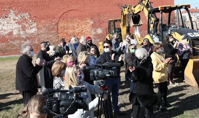 Denison residents gather for the groundbreaking of the Designing Downtown Denison project in January. Crews have begun closing roads as a part of utility improvements related to the project.