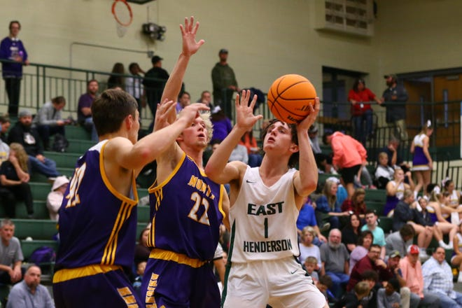 East Henderson's Alex Taylor (1) shoots the ball against North Henderson's Brayden Corn (22) and Luke Stepp during a game last year at East.