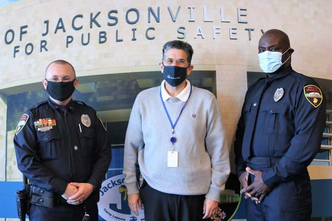 Jacksonville Police Officers Dale R. Rossiter Jr. and Robert L. Ford Jr. recently took their oaths and pinned on their badges to serve and protect the citizens of Jacksonville during a ceremony at the Center of Public Safety building. They are pictured with Police Chief Mike Yaniero.