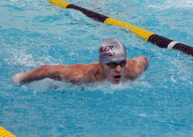 Buhler's Spencer Hines competes in the 100-yard butterfly Monday at the Newton Invitational II.