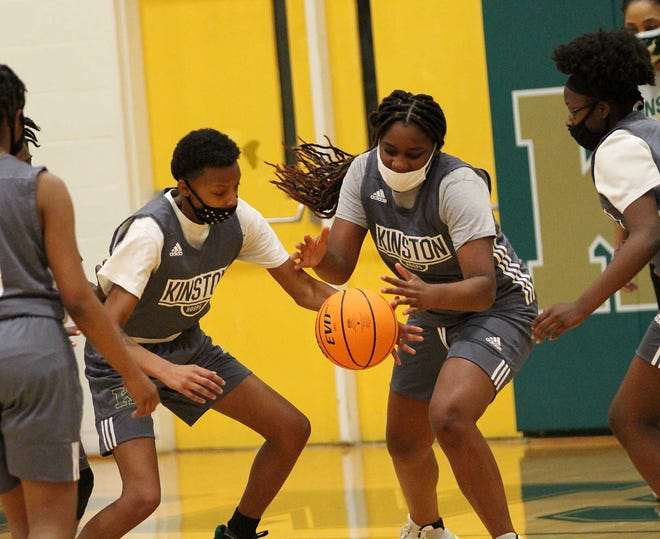 Winter Lane (right) had a big week for the Kinston High girls basketball team as the Vikings remain perfect in conference play.