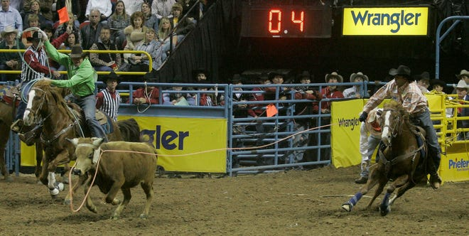 David Key, left, of Caldwell, Texas, left, and Kory Koontz, Sudan, Texas, take part in the ninth go-round of team roping at the National Finals Rodeo on Dec. 8, 2006 at the Thomas & Mack Center in Las Vegas. Key and Koontz tied for first in Friday's go-round. [AP Photo/Chris Carlson]