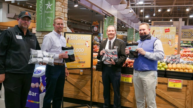 """The United Family donated 1,000 pairs of socks to the Salvation Army of Lubbock as part of a program called """"Pears for Pairs."""