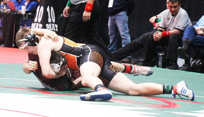 La Junta High School's Mitchell Peabody turns Alamosa's Austin Trujillo on his back in last year's state tournament. Peabody is one of three returning state qualifiers.