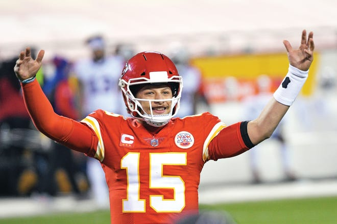 Kansas City Chiefs quarterback Patrick Mahomes celebrates at the end of the AFC championship NFL football game against the Buffalo Bills, Sunday, Jan. 24, 2021, in Kansas City, Mo. The Chiefs won 38-24.