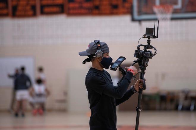 WMCT-TV camera operator Raeshawn Link films a Marlborough High boys varsity basketball game against Hudson High, Jan. 22, 2021.