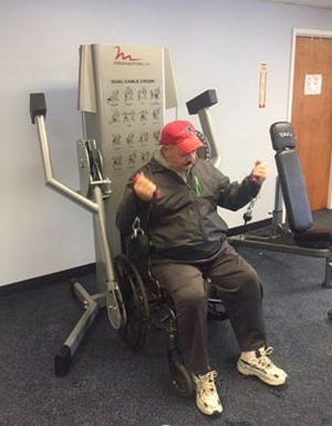 A resident works out in the newly renovated exercise room at Donovan Manor.