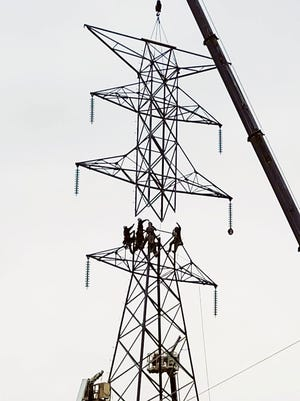 Employees worked over the weekend to repair the TVA electrical transmission tower that was damaged Friday afternoon when it was reportedly hit by a pickup truck, knocking out power to most of Oak Ridge.