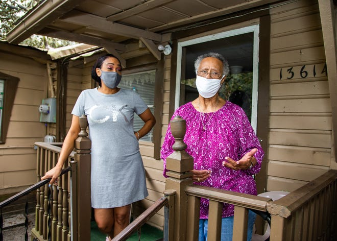 Hattie Hanks, right, talks about repairs needed at her home in Weirsdale. Community With a Heart has decided to help Hanks with some tree trimming and an electrical problem. At left is her daughter, Cindy Hanks-Woods.