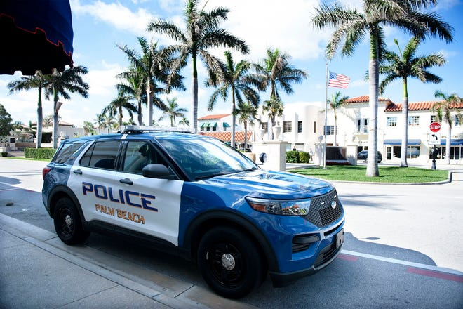 Palm Beach Police Officer Gabri Badolati has been driving this Ford gas-electric hybrid utility vehicle since last year. The town recently approved buying two more hybrid vehicles for the police department. MEGHAN McCARTHY/Palm Beach Daily News