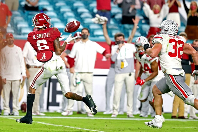 Alabama receiver DeVonta Smith hauls in one of his three touchdown catches against Ohio State in the national championship game earlier this month at Hard Rock Stadium.