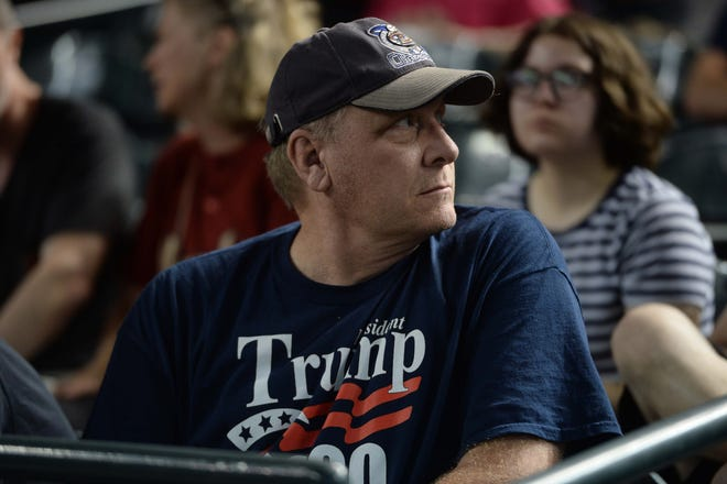 Former pitcher Curt Schilling looks on during a game between the Arizona Diamondbacks and San Francisco Giants at Chase Field in 2018. Schilling may need more than Hall of Fame numbers to get into Cooperstown, along with Barry Bonds and Roger Clemens.