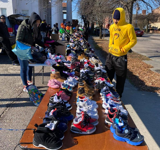 Team Petersburg hosts pop-up shoes give-a-way along East Washington Street in downtown Petersburg on Jan. 23, 2021.