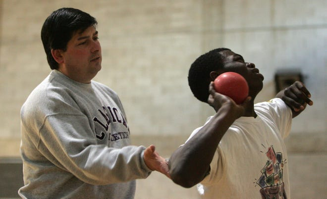 Bob Palazzo works with Joshua Faboyede during a practice at Classical several years ago. Palazzo was named the 2020 National Track and Field Coach of the Year.