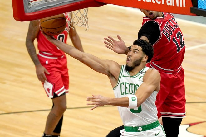 Boston's Jayson Tatum scores on a reverse layup during the first half of Monday night's game against the Chicago Bulls,.