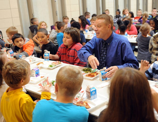 Ravenna superintendent, Dennis Honkala, has lunch with second graders at Willyard Elementary.