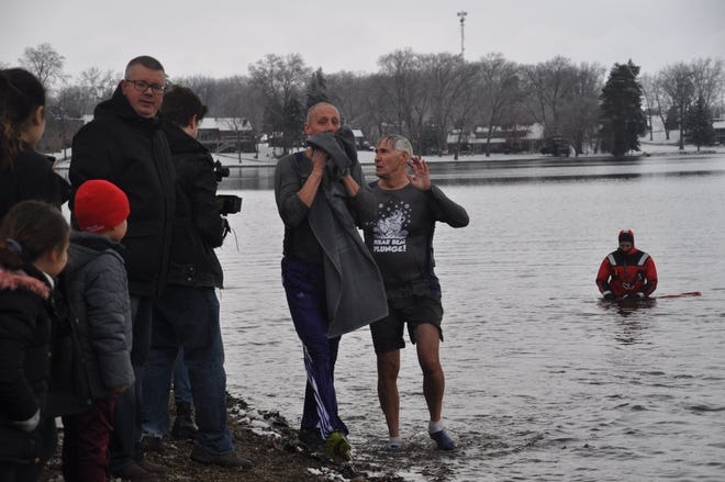 Jackson Local Schools Superintendent Christopher DiLoreto and JLFS past board president Jim Camp come out of the icy cold Lake Cable at the 2020 Polar Bear Plunge.