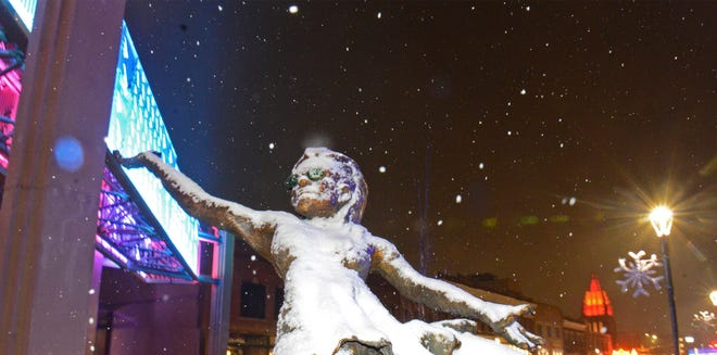 """Snow starts to build on the """"Ballet was not an Option"""" sculpture by Salina native Tim Chapman, of Hays, on Monday evening."""