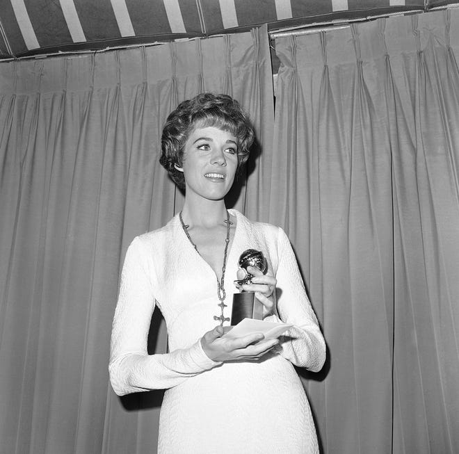 """Julie Andrews holds her Golden Globe for Best Actress in """"The Sound of Music"""" on Jan. 31, 1966, in Hollywood, Calif."""