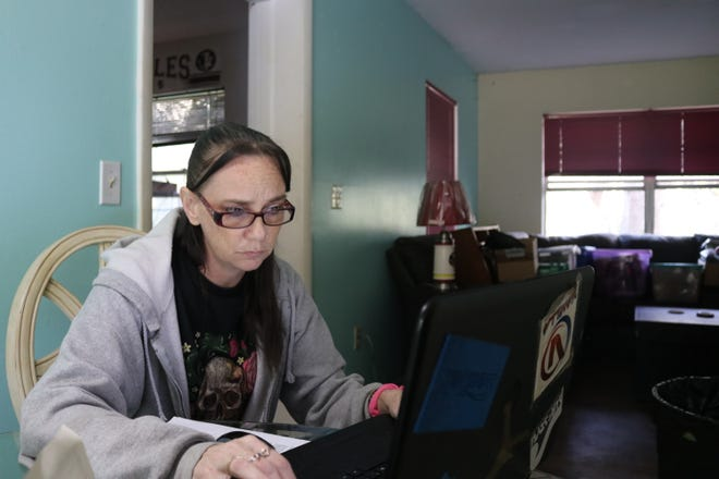 Katrina Perkins, 40, applied for Florida's pandemic unemployment assistance Tuesday morning. Since April, Perkins' main source of income has been gig work through grocery and food delivery apps.