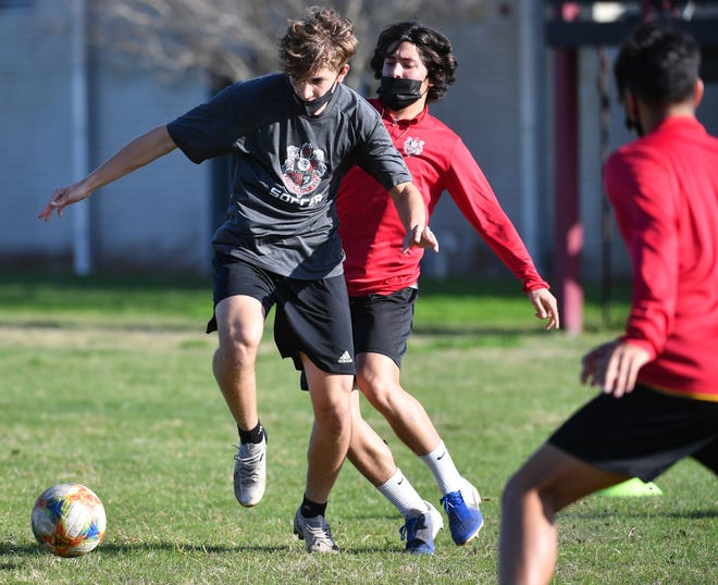Palmetto High boys soccer players fight for control of the ball during drills at practice on Monday.