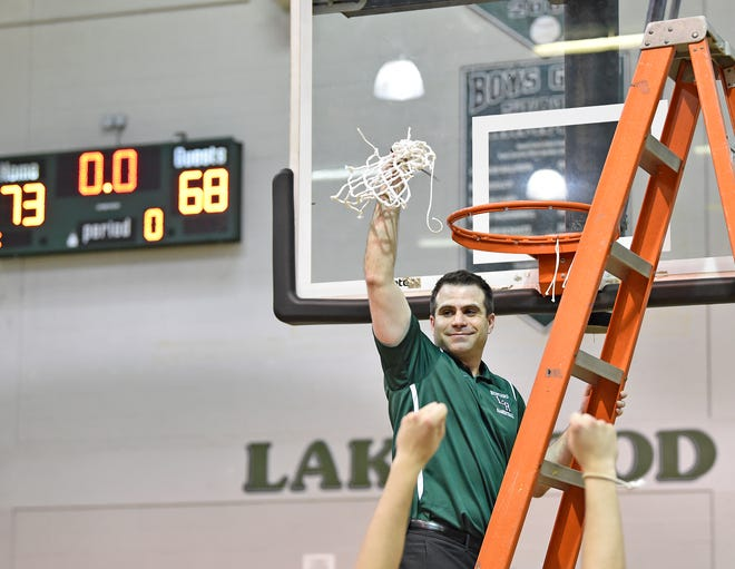 "Lakewood Ranch Mustangs' head coach Jeremy Schiller celebrates the net-cutting after a 73-68 win over St. Petersburg during the Boys 8A-Region 3 region final game Friday evening February, 24, 2017, at Lakewood Ranch High School's gymnasium. Schiller and Braden River coach Jason Mickan will participate in the Coaches vs Cancer Fundraiser called ""Suits and Sneakers."""