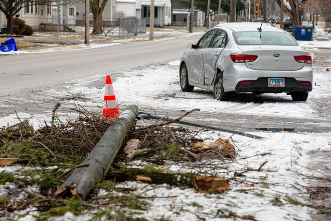 A knocked over utility pole and a sideswiped car show the damage done the morning after a car accident involving a shots-fired call Monday night along the 1200 block of West Ash Street in Springfield. According to Springfield police, at approximately 8:51 p.m. Monday witnesses reported two vehicles traveling west on Ash Street with subjects in one vehicle firing on the other vehicle. The suspect vehicle crashed into several parked cars and three occupants suffered various injuries and were transported to the hospital. [Justin L. Fowler/The State Journal-Register]