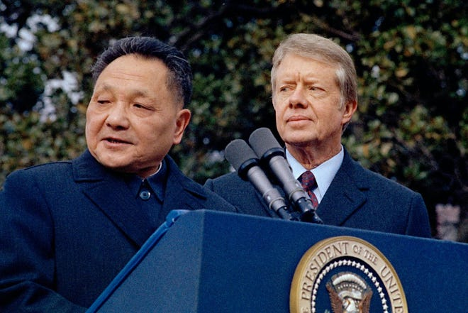 In this Jan. 29, 1979, photo, then U.S. President Jimmy Carter, right, and then Chinese Vice Premier Deng Xiaoping are seen outside the White House.