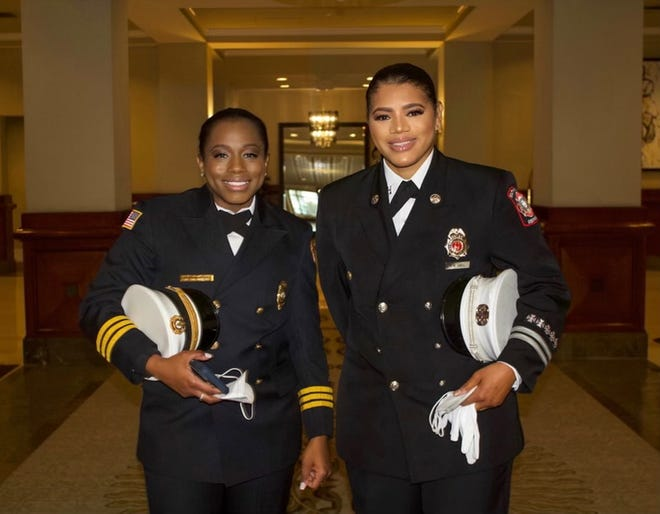 Savannah Fire Department Chief Fire Marshal Whitney Williams-Smith stands next to sister Andrea Hall, who is the City of South Fulton Fire Rescue captain.