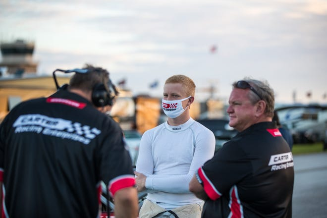 Savannah's Michael Carter, center, a 2018 Benedictine graduate, is balancing being a college student at Georgia Tech with competing on a professional auto racing circuit.